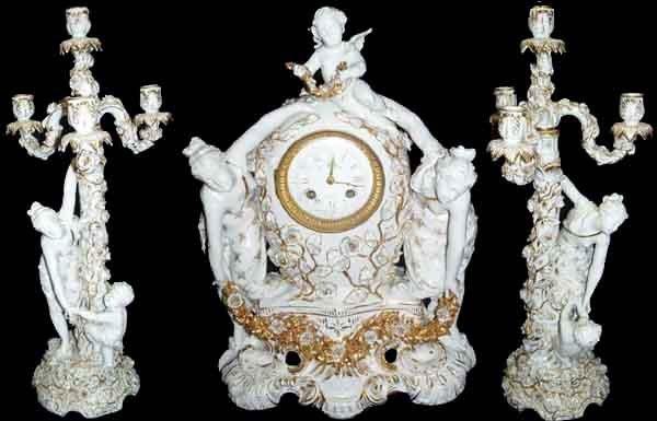 1610: 19th C. porcelain 3 pc. figural clock set