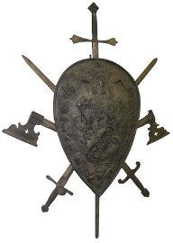 572: 19th C. cast iron shield w/weapons