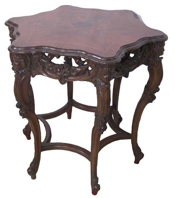 7: Ca. 1890 carved walnut center table w/inlaid top