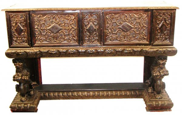 12: 18th C. carved cassone with detail carved lions on