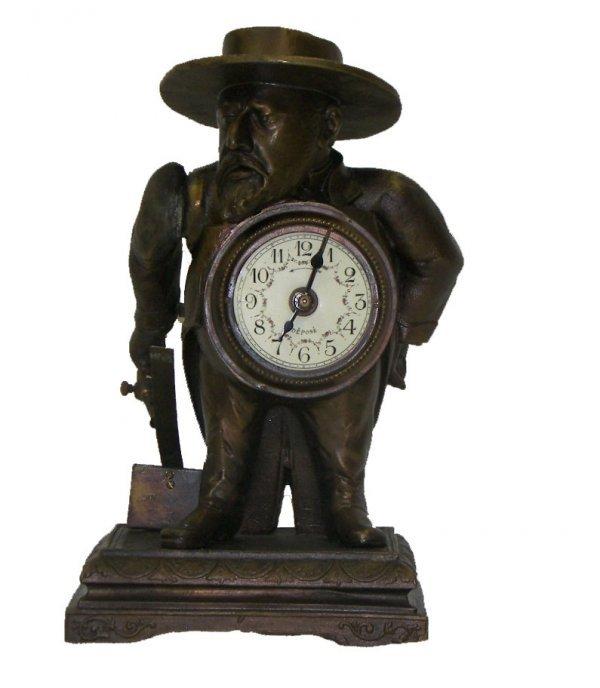 21: French figural match holder strike clock