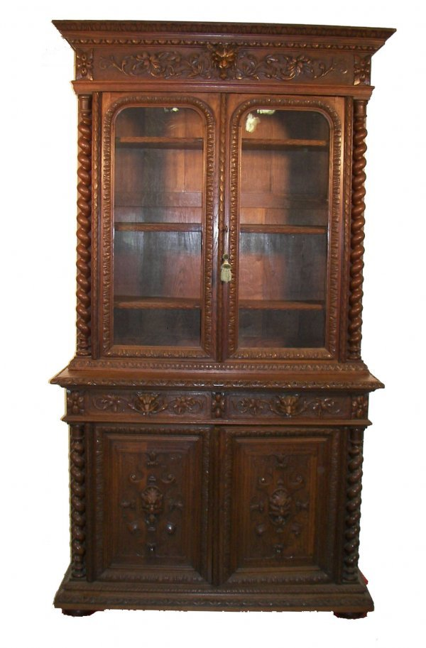 3: Early 19th C. figural carved oak 2 part cabinet