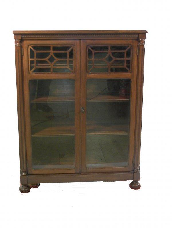24: Walnut 2 door bookcase with bun feet