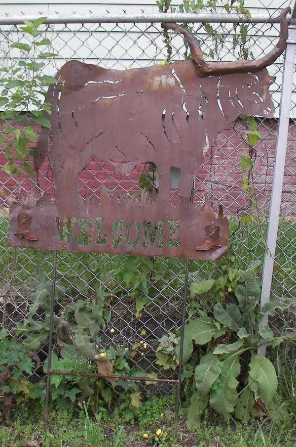 13: Wrought iron welcome sign with steer