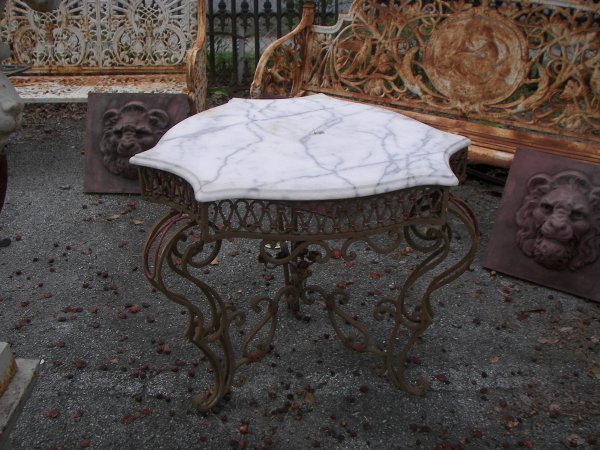 31: Marble top wrought iron table with flower base