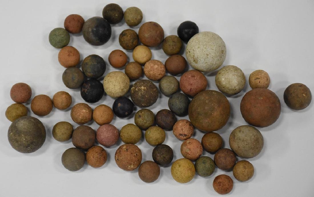 Total of 57 antique clay marbles, variation in color: