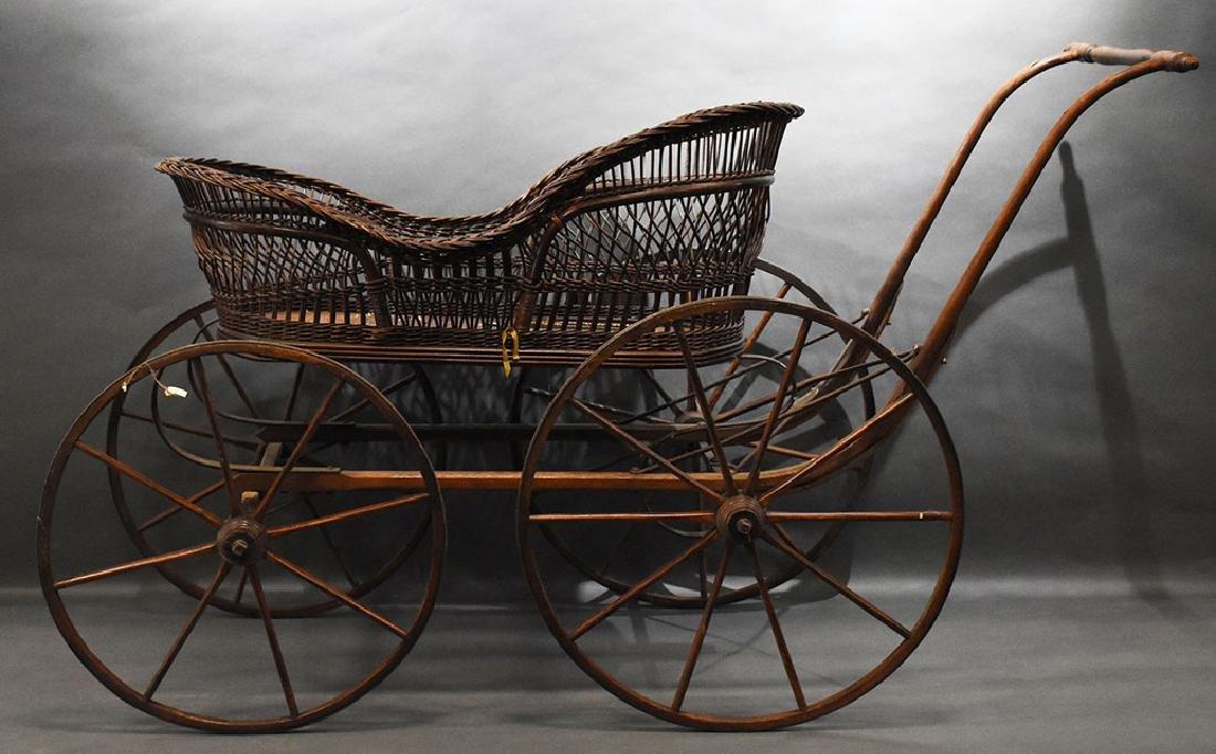 "Antique Victorian wicker baby bugger, 34"" H 55"" W"