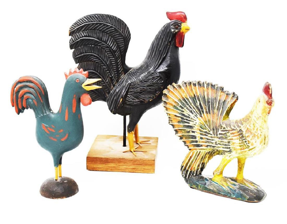 3 carved wooden chickens