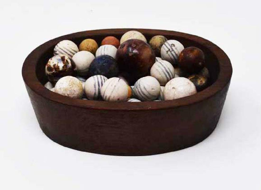 Walnut oval bowl w/approximately 43 clay marbles