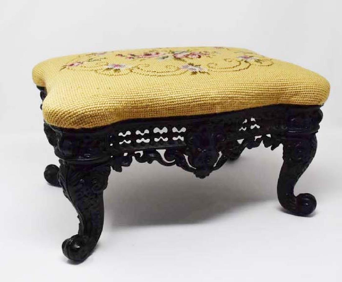Footstool with ornate cast iron frame
