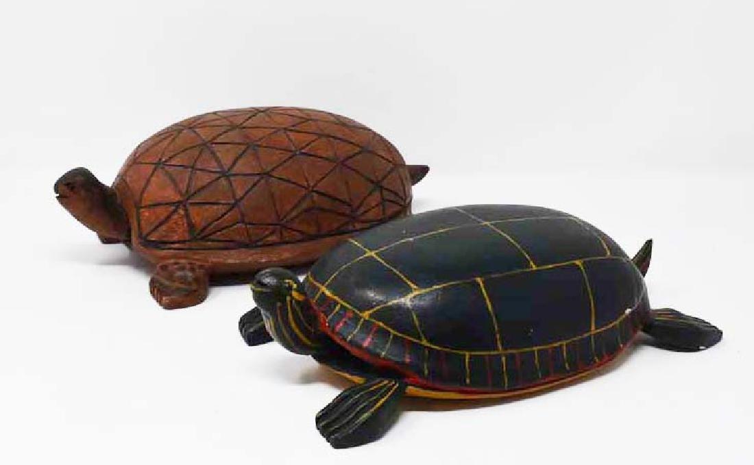 2 carved wooden turtles