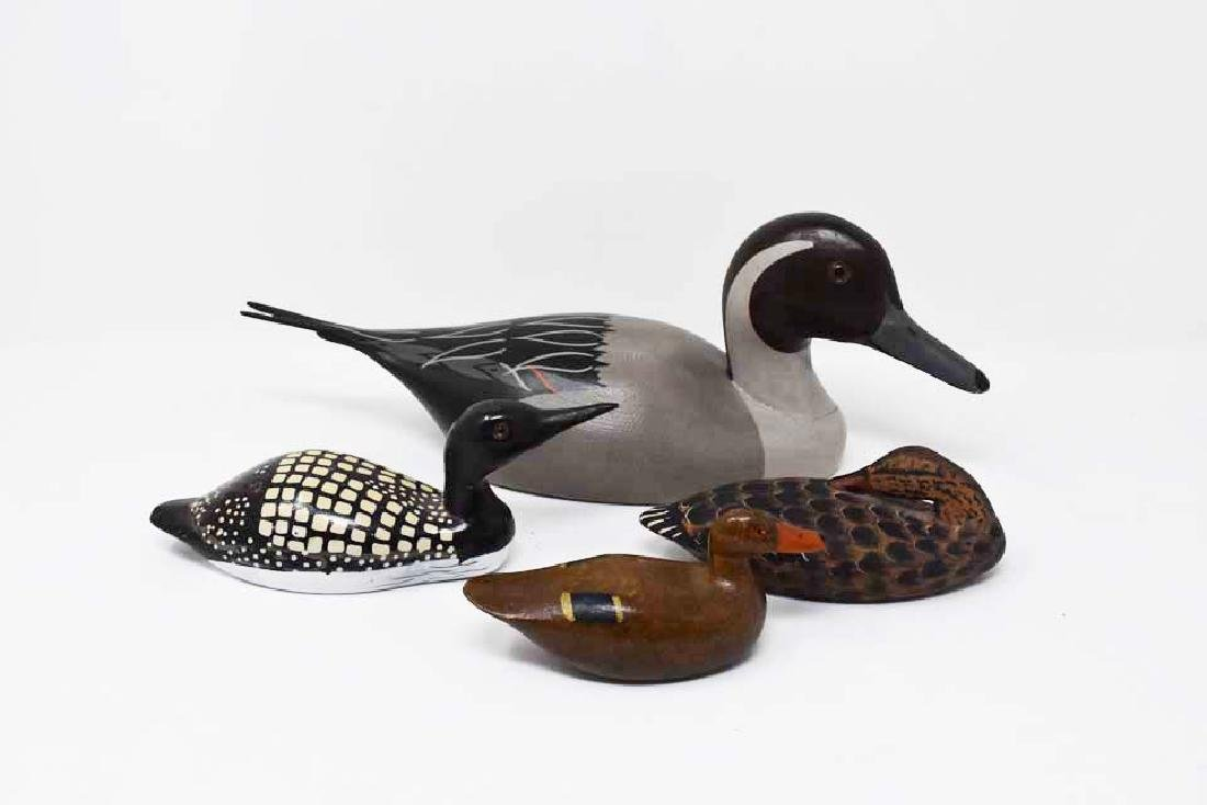 4 carved wooden ducks