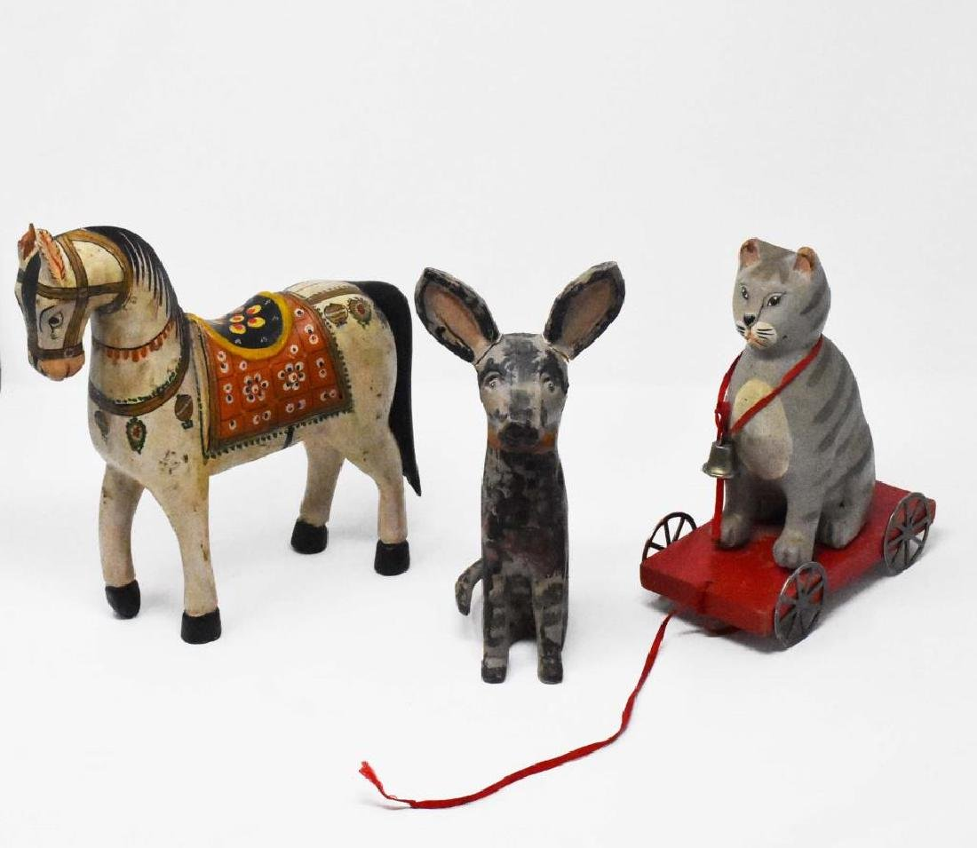 3 carved wooden animals