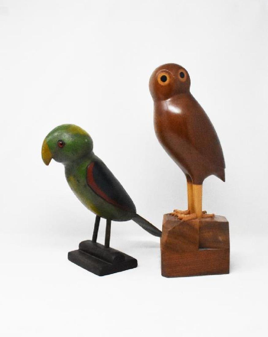 2 carved wooden birds