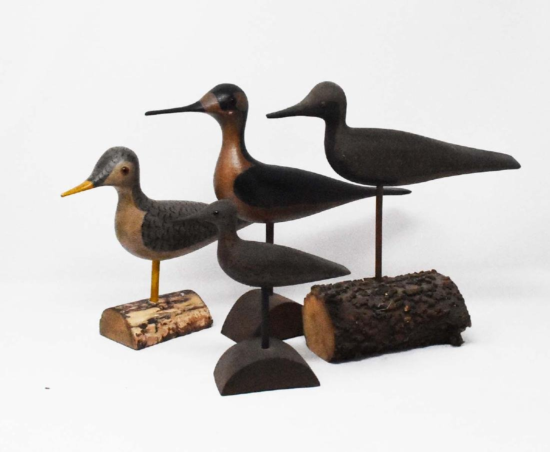 4 carved wooden shore birds
