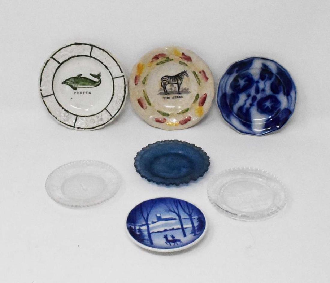 7 antique cup plates