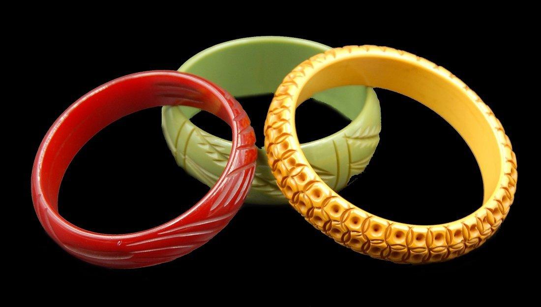 3 Carved Bangle Bracelets Cherry Red, Carammel, Green