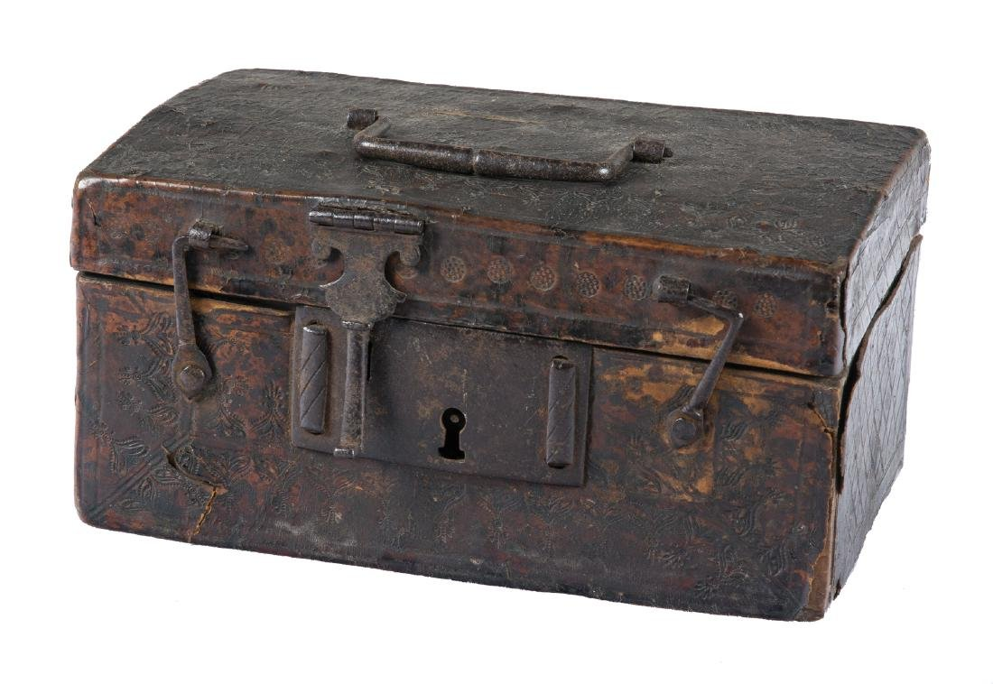 Engraved cordovan leather chest with iron fittings and