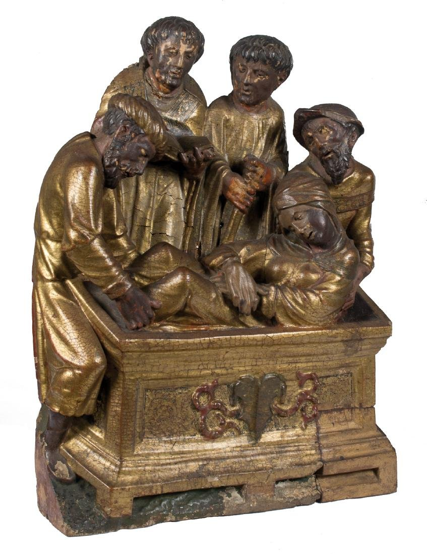 Carved, gilded and polychromed wooden sculptural group.
