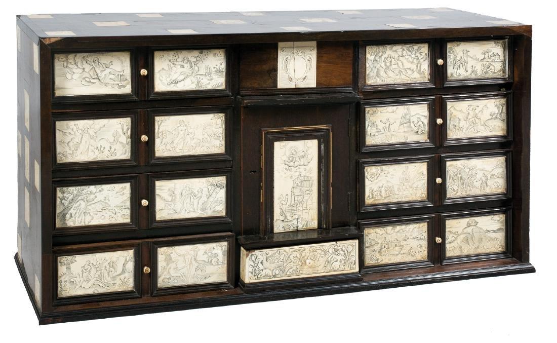 Ebonized wood and pyrogravured ivory chest.  Flemish.