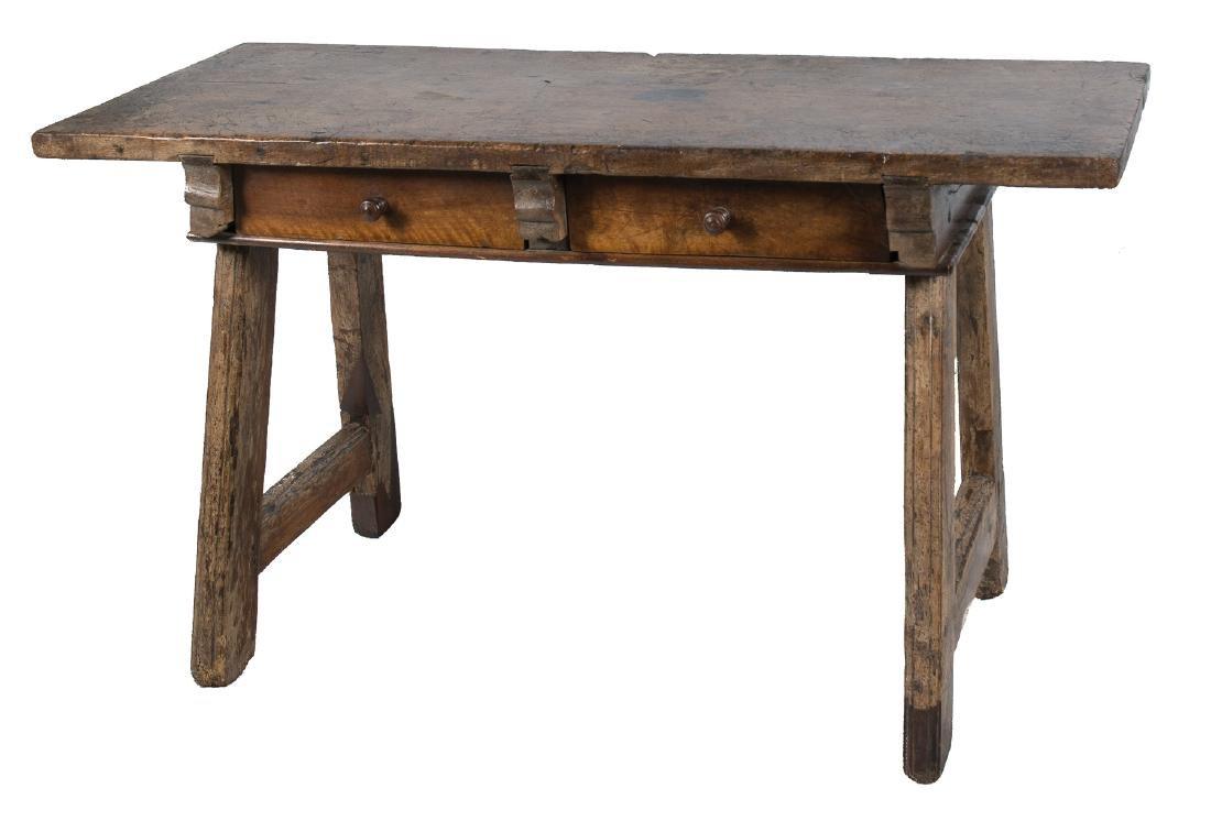 A spanish walnut wood table.  17th century.
