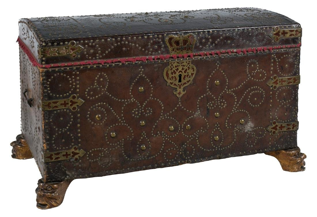 Large wooden chest covered with studded leather and
