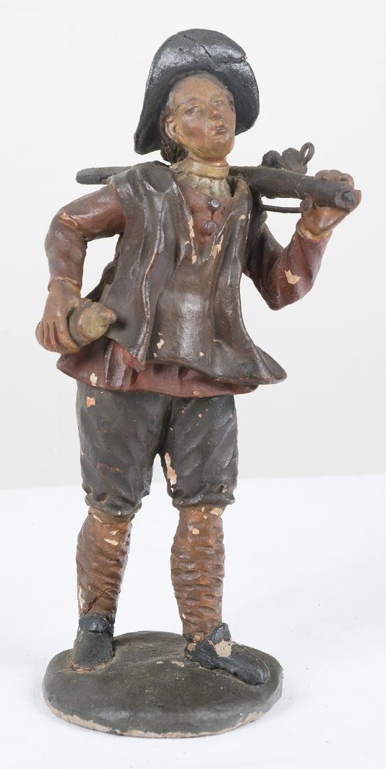 """Hunter"" Polychromed terracotta sculpture."