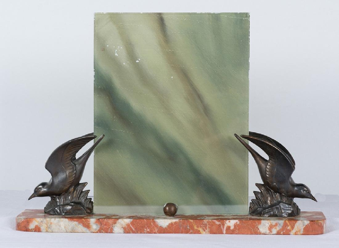 Patinated picture holder with a marble base. Art Deco.