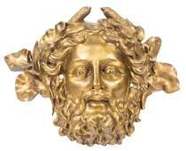 Pair of large gilded bronze mascarons France Circa
