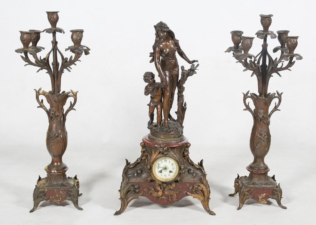 Large decorative set of clock and pair of candelabras.
