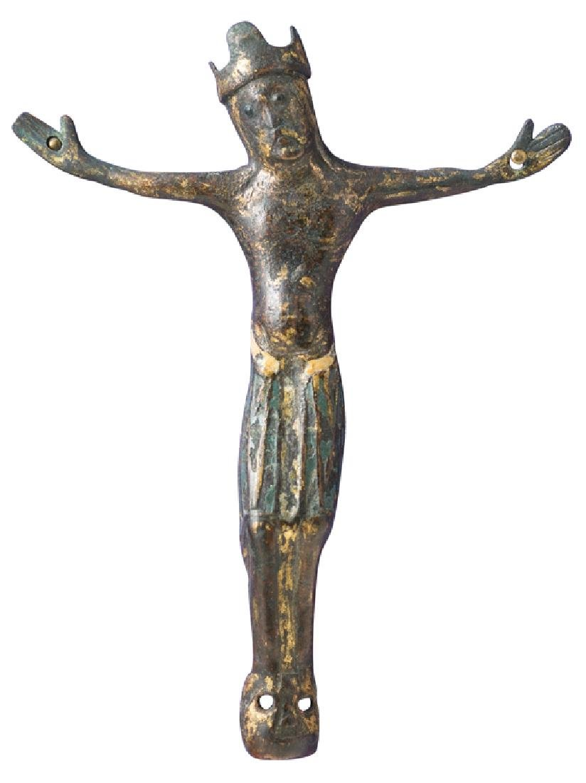Gilded copper Christ figure with champlevé enamel.