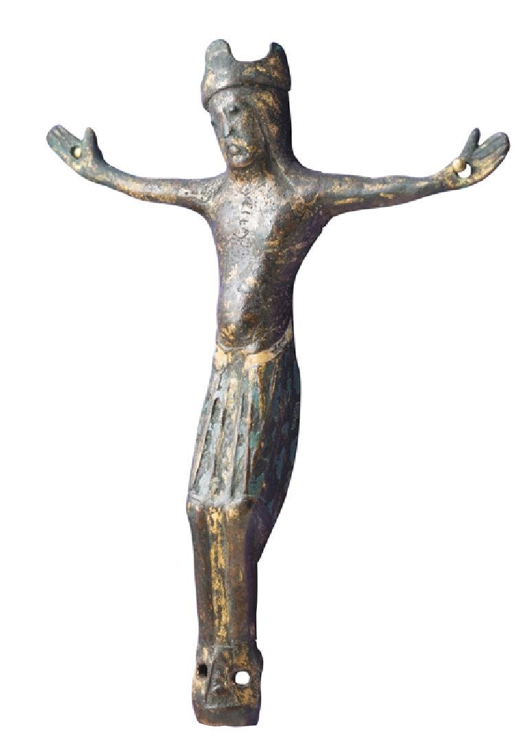 Gilded copper Christ figure with champlevé enamel. - 2