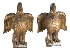 Eagles Pair of carved and gilded wooden sculptures.