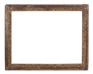 Gran marco en madera tallada con restos de policroma y