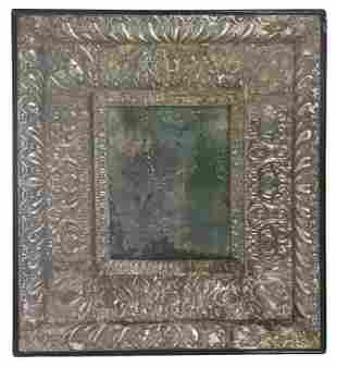 Mirror with wooden frame covered in embossed silver