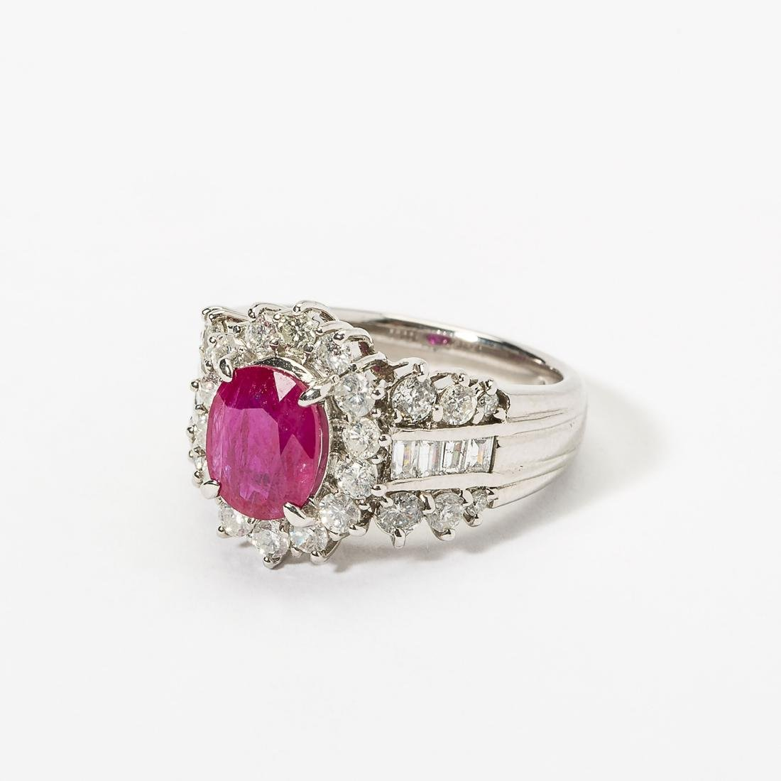 A platinum, diamond and ruby ring