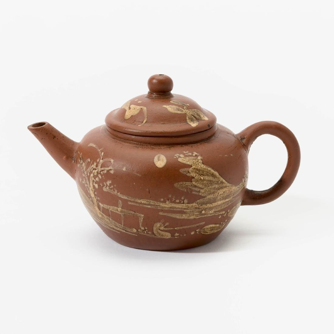 A Chinese miniature Yixing teapot and cover
