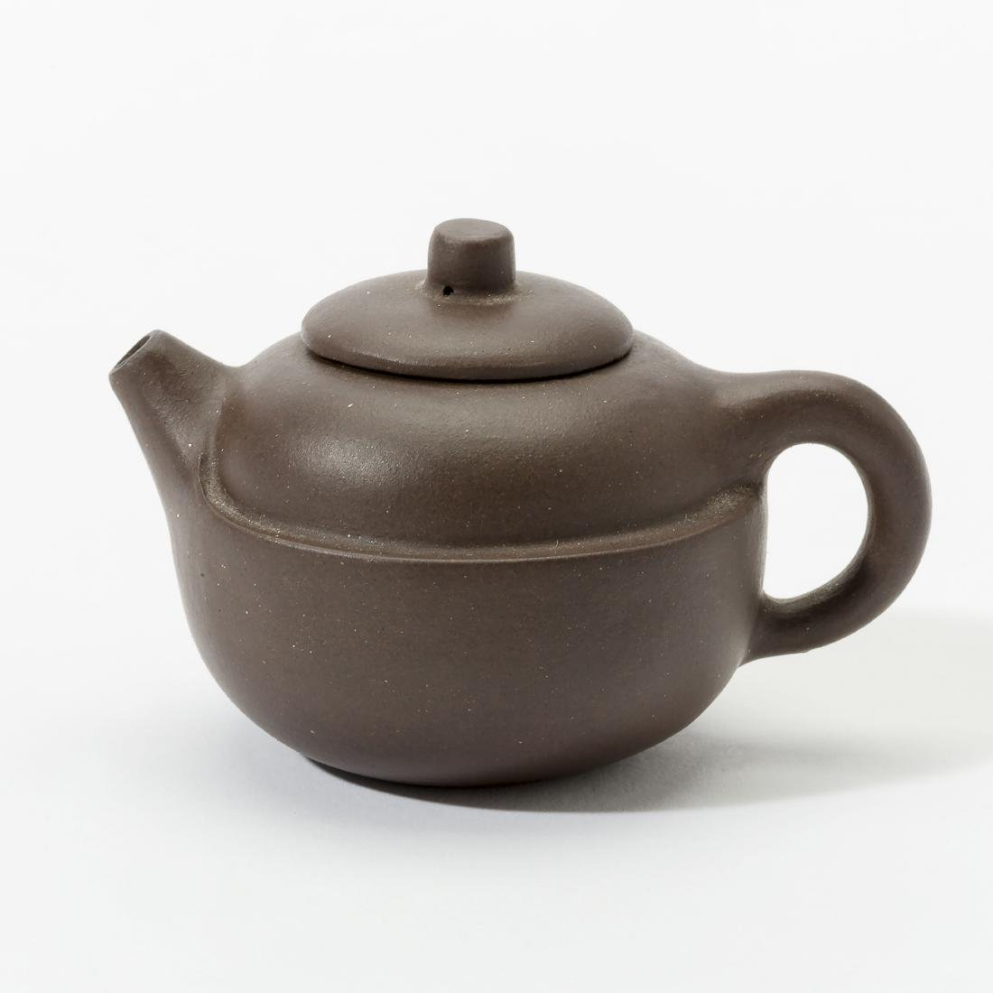 A Chinese 'purple clay' Yixing miniature teapot and