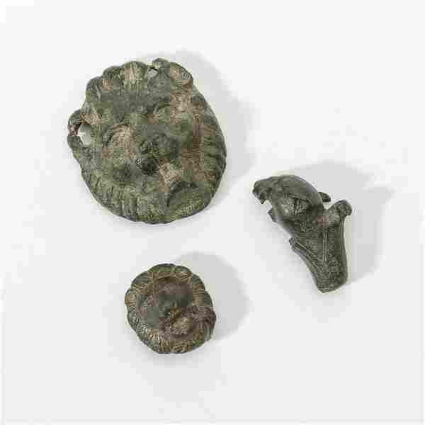 Three bronze appliques