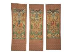 THREE TIBETAN KESI SEATED BUDDHA THANGKA