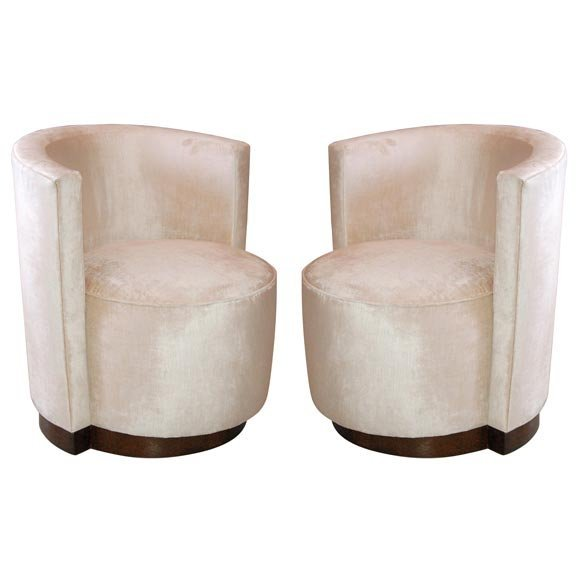 A pair of French Art Deco Barrel Back Chairs