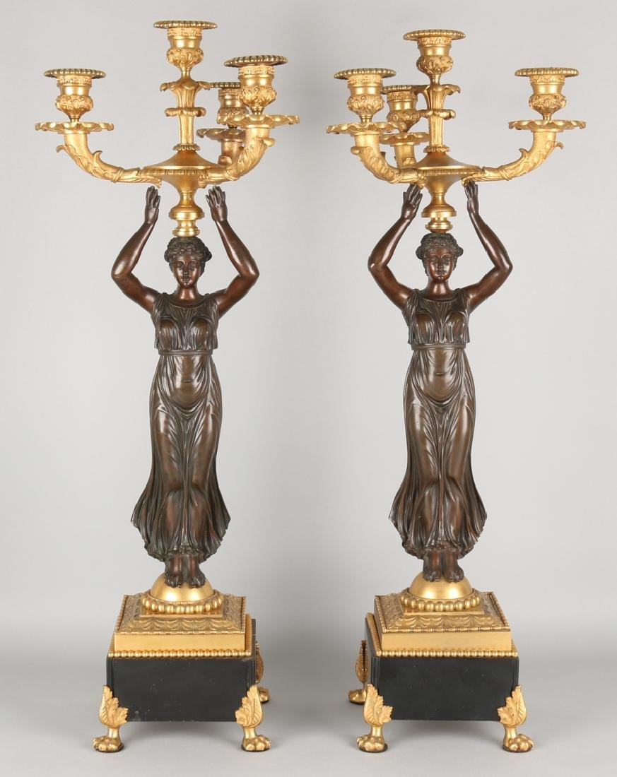 Two large 19th century bronze empire-style candlesticks