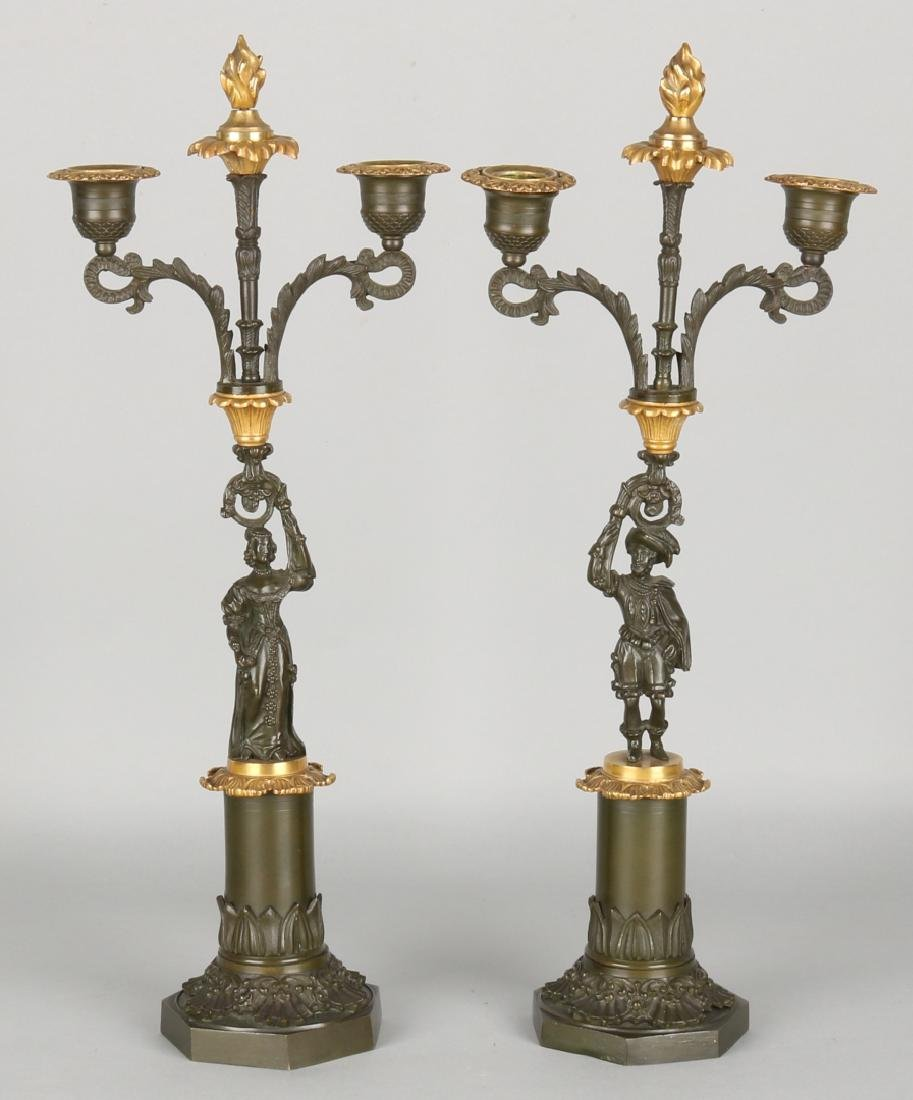 Two antique bronze, green patinated empire candlesticks