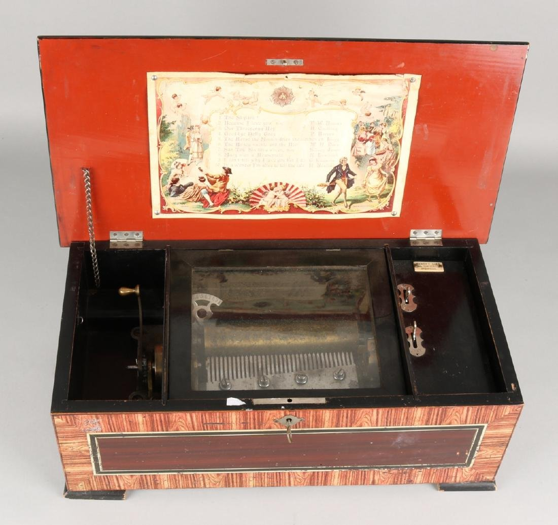 Large antique Swiss music box with ten melodies. Mahoga