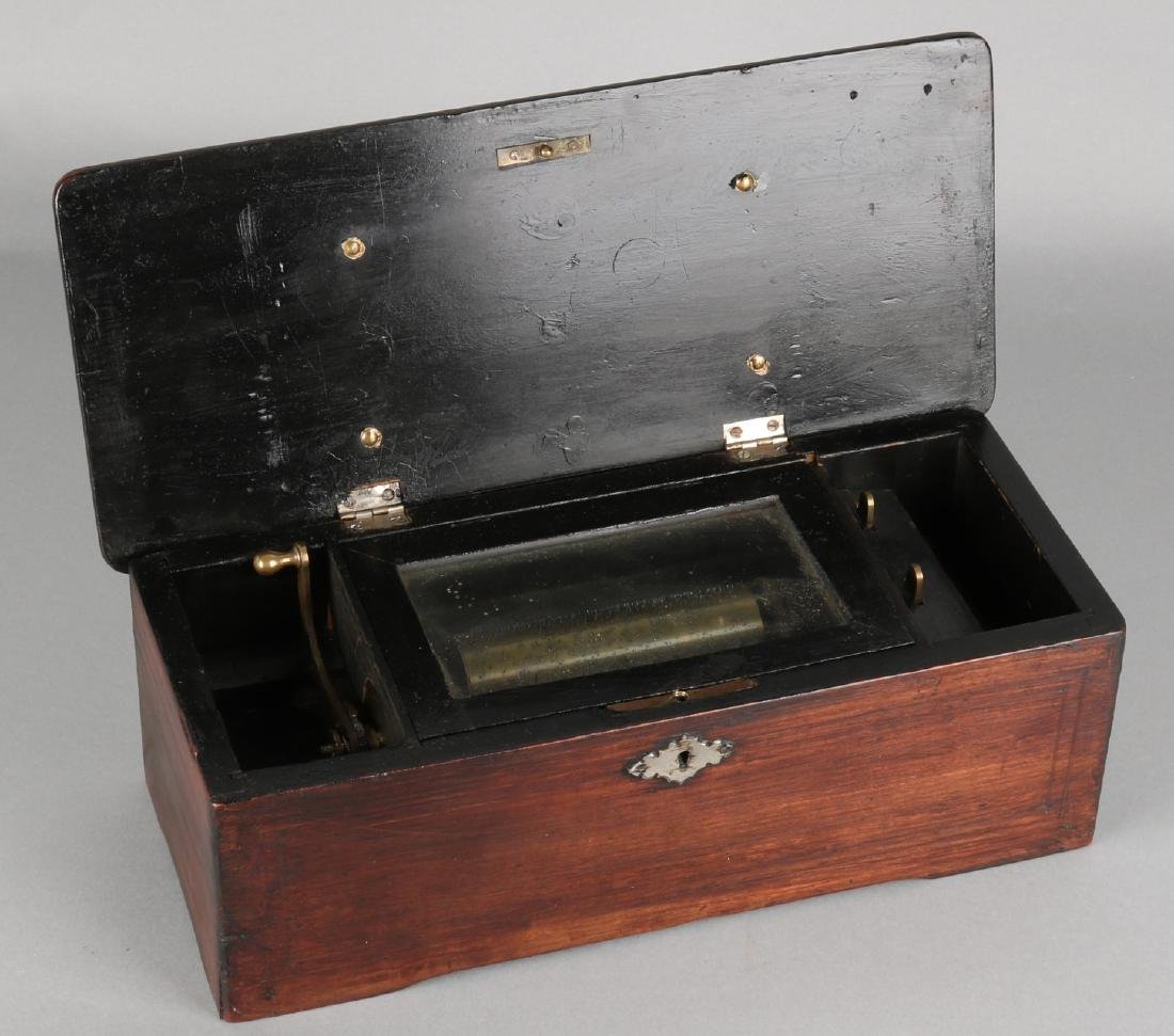 Small defective antique Swiss music box. Feather broken