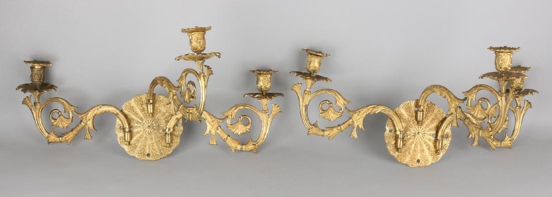 A pair of rare fire-gilt bronze three-light Empire cand
