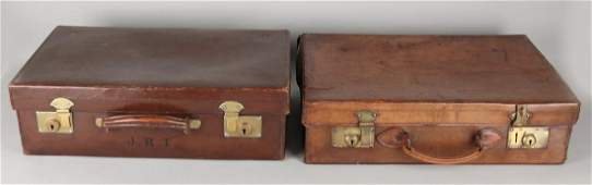 Two antique brown leather suitcases. England. One suitc