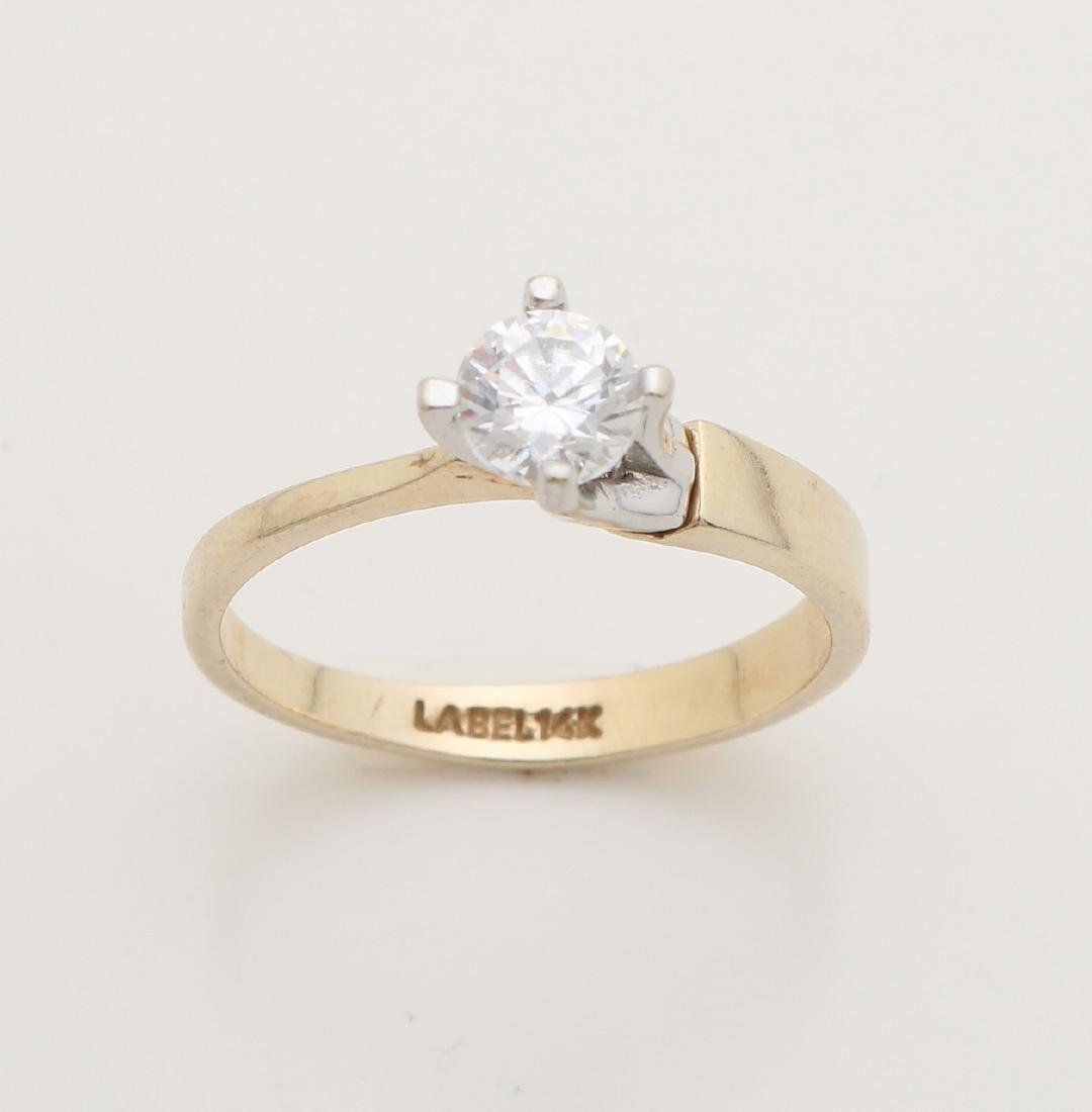 Yellow gold solitaire ring, 585/000, with diamond. Ring with a band in thickness