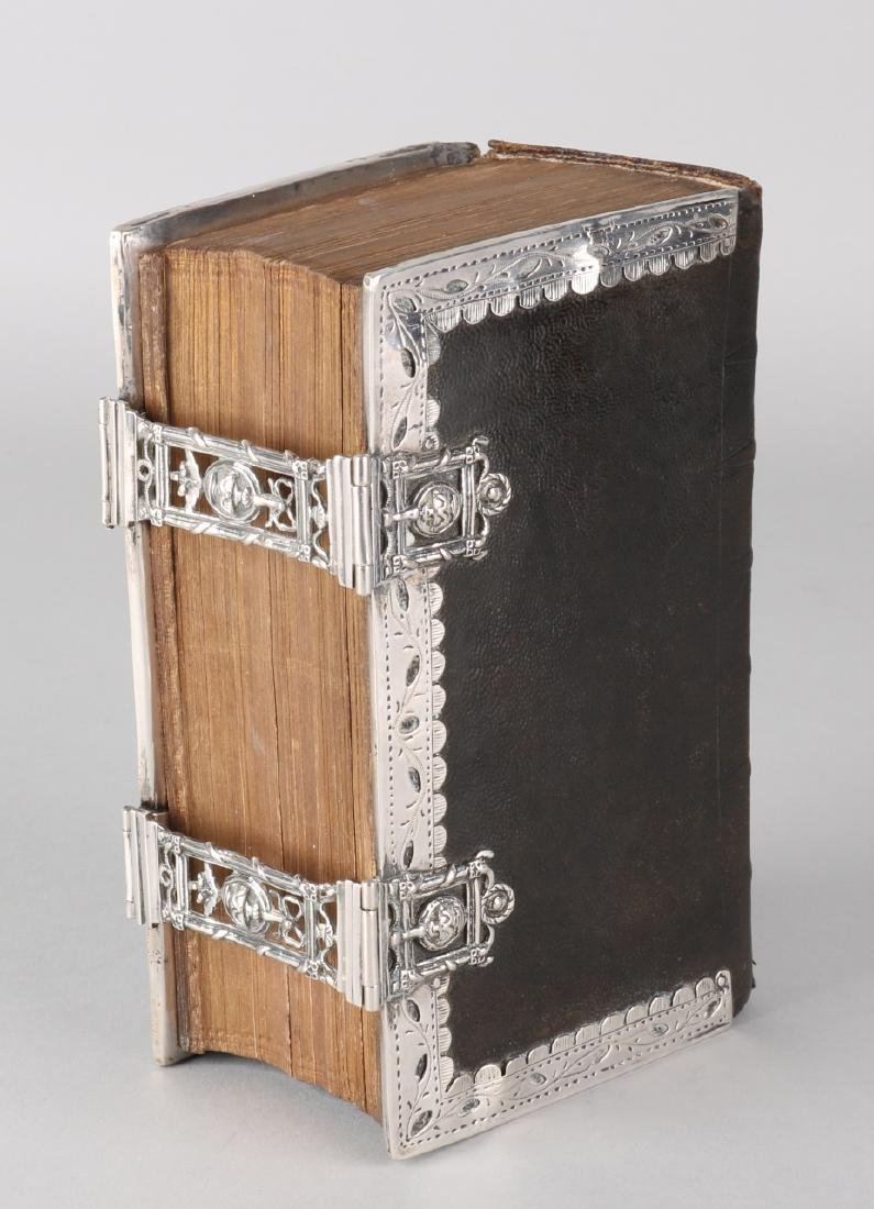 Bible with silver locks and borders, 833/000. Bible with leather cover: The New