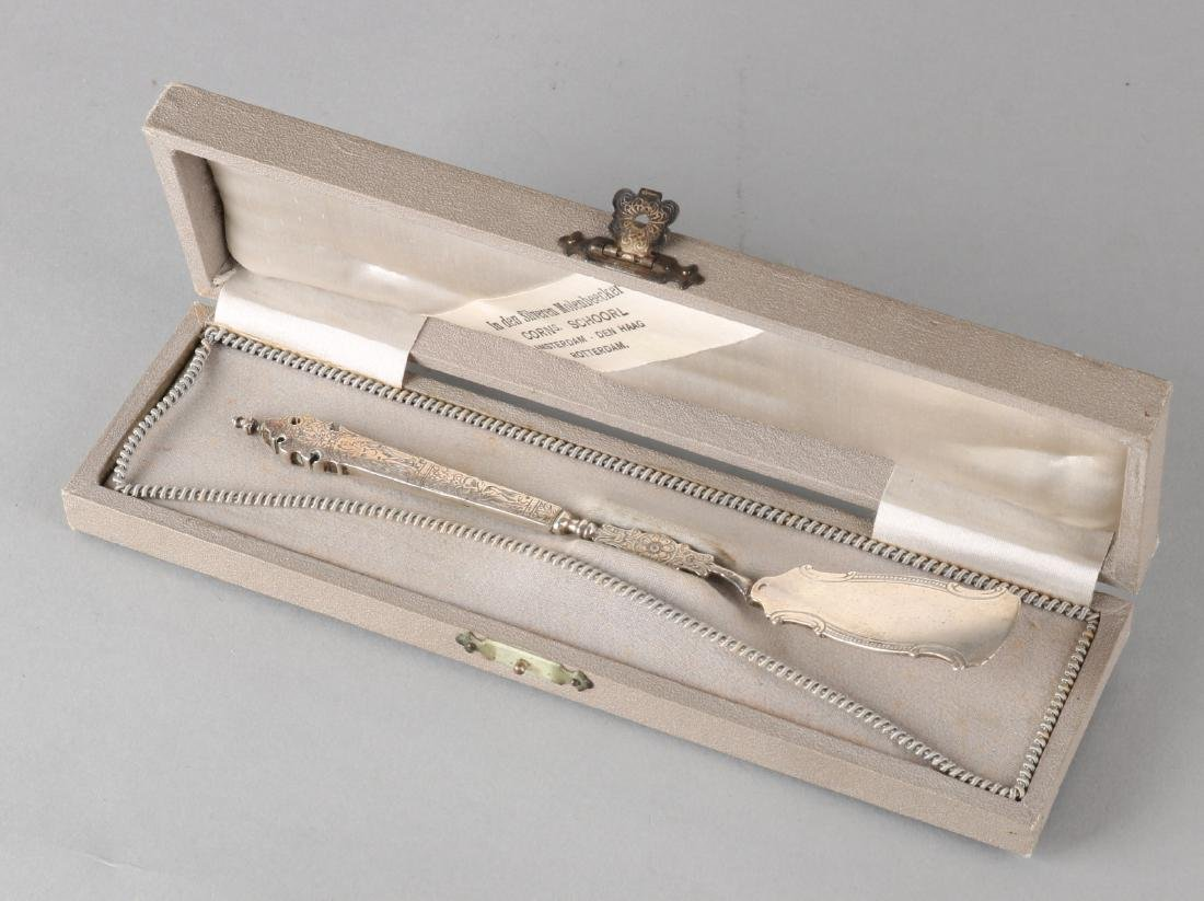 Silver butter knife, 835/000, with a steered handle with religious engravings an